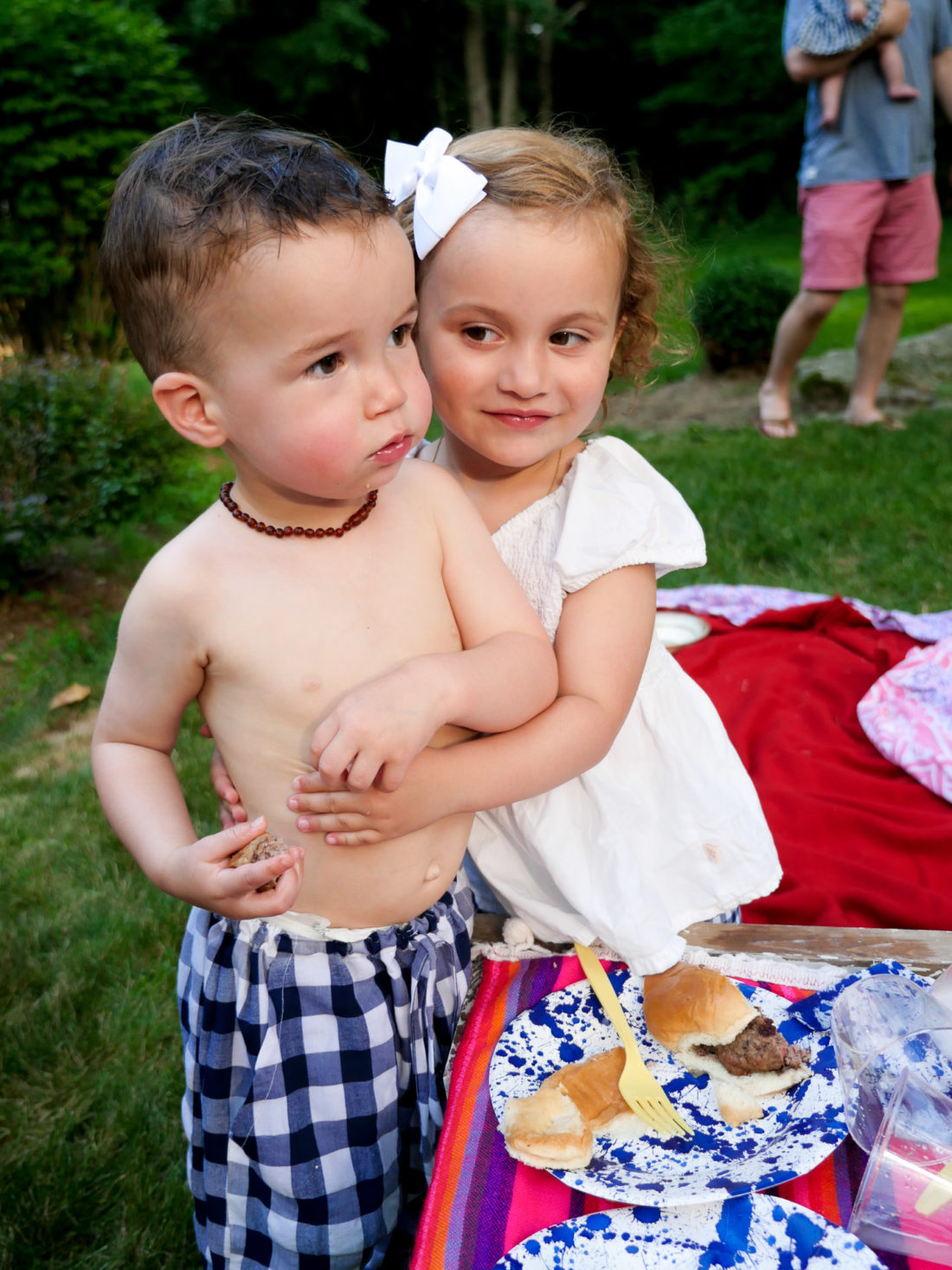 Major Martino gets a hug from a sweet little girl on the fourth of july in Connecticut
