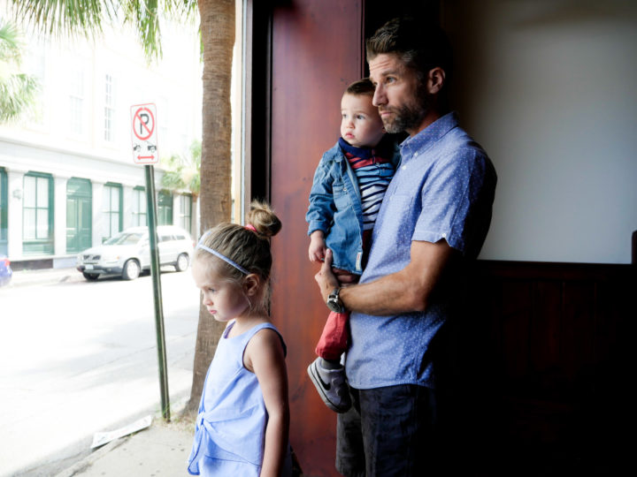 Eva Amurri Martino's husband Kyle looks out onto the Charleston street with their kids Marlowe and Major