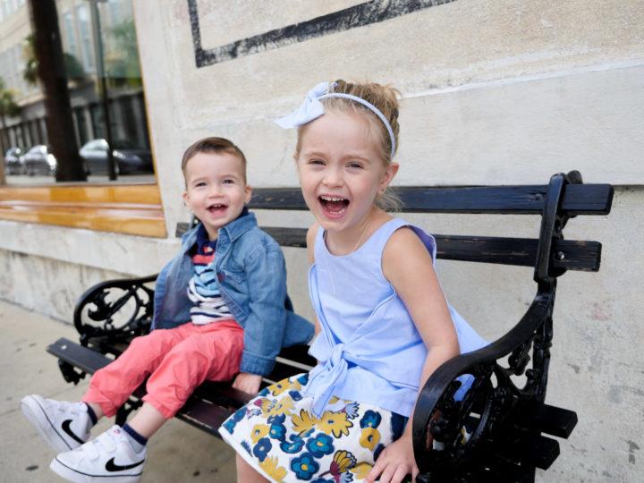 Eva Amurri Martino's kids Marlowe and Major laughing on a park bench in Charleston.