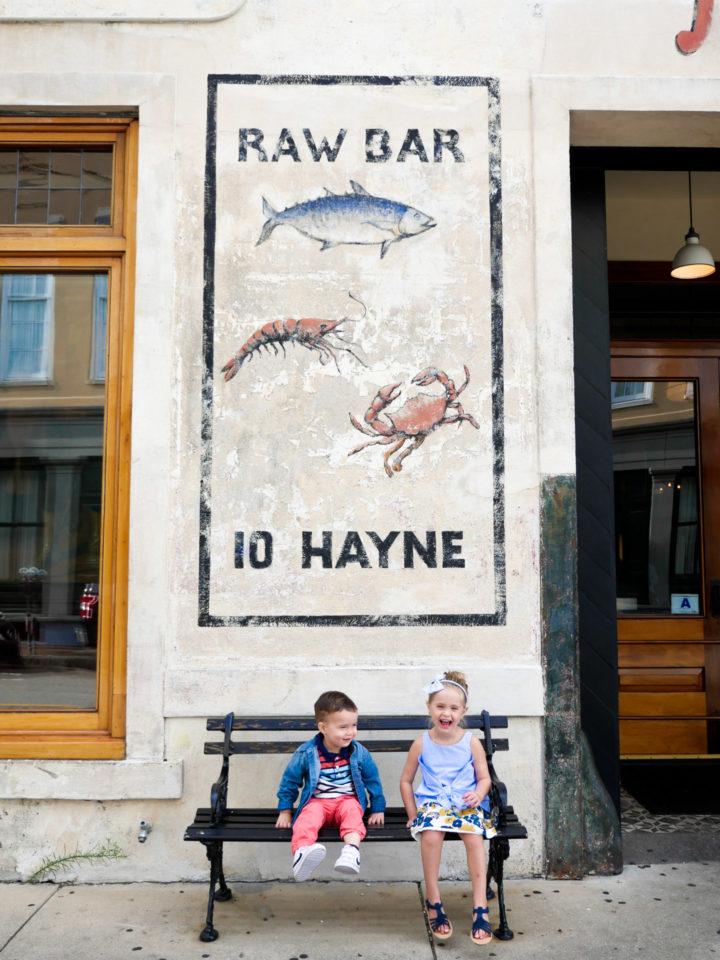 Eva Amurri Martino's kids Marlowe and Major sit outside of a raw bar in Charleston