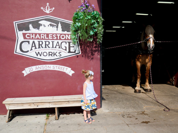 Eva Amurri Martino's daughter Marlowe stands in front of Charleston Carriage Works