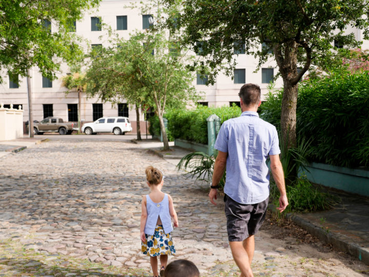 Eva Amurri Martino's husband Kyle and daughter Marlowe walk together through the streets of Charleston