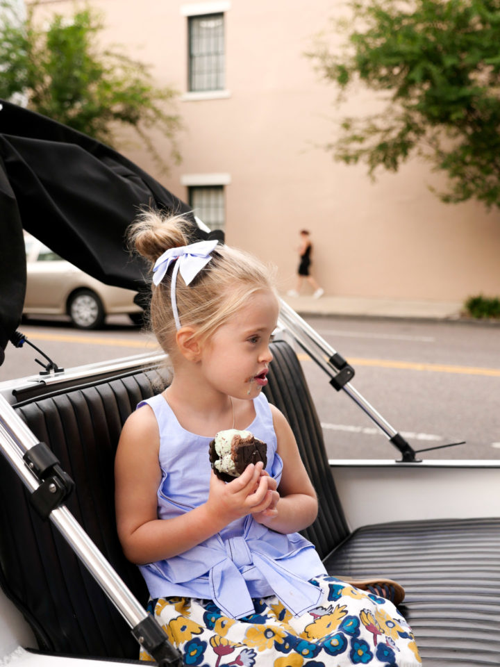 Eva Amurri Martino's daughter Marlowe covets her ice cream sandwich while sitting in the back of a peddy cab