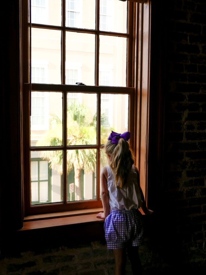 Eva Amurri Martino's daughter Marlowe looks out the window of their Charleston rental home