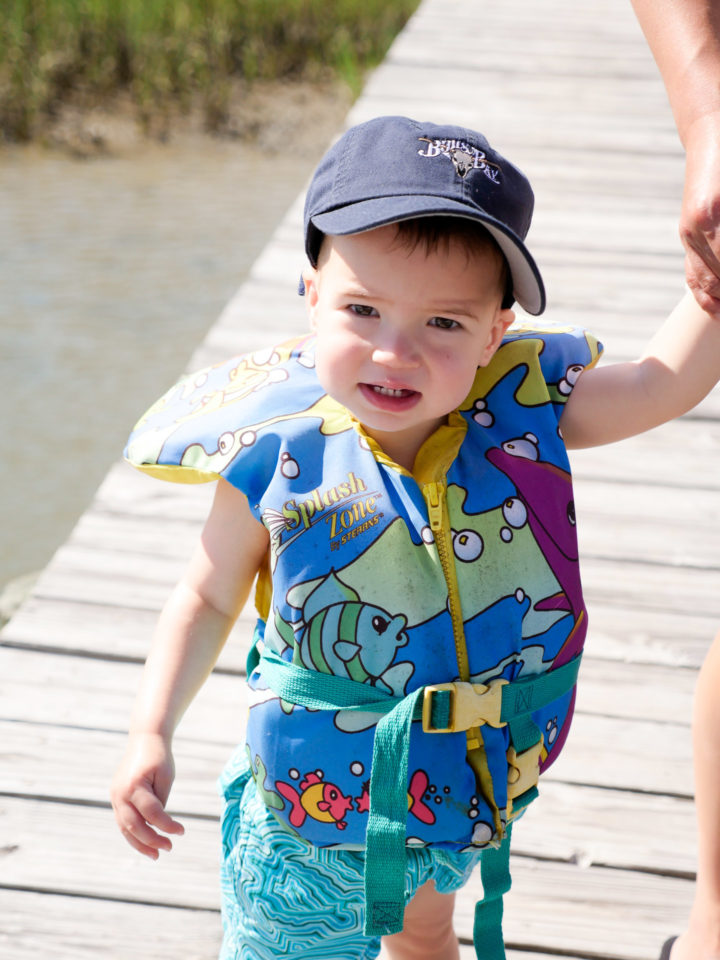 Eva Amurri Martino's son Major wears a baseball cap and a lifejacket on his way to ride on a boat with his grandparents