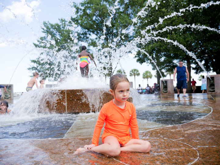 Eva Amurri Martino's daughter Marlowe sits in the sprinklers in Charleston