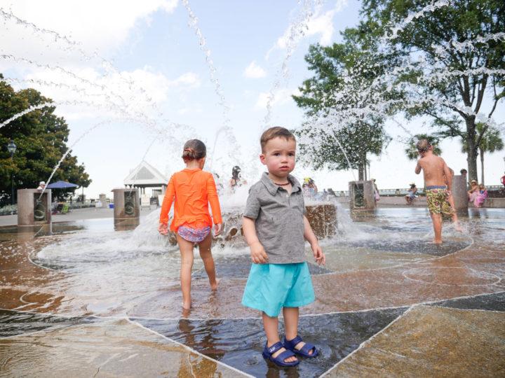 Eva Amurri Martino's daughter Marlowe and son Major running through the sprinklers in Charleston