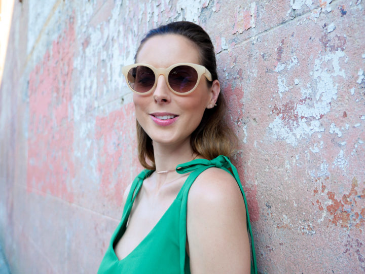 Eva Amurri Martino wears a pair of stylish nude sunglasses and a green sundress in Charleston
