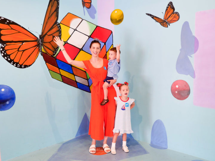 Eva Amurri Martino and her children Marlowe and Major pose in front of a colorful backdrop in Charleston
