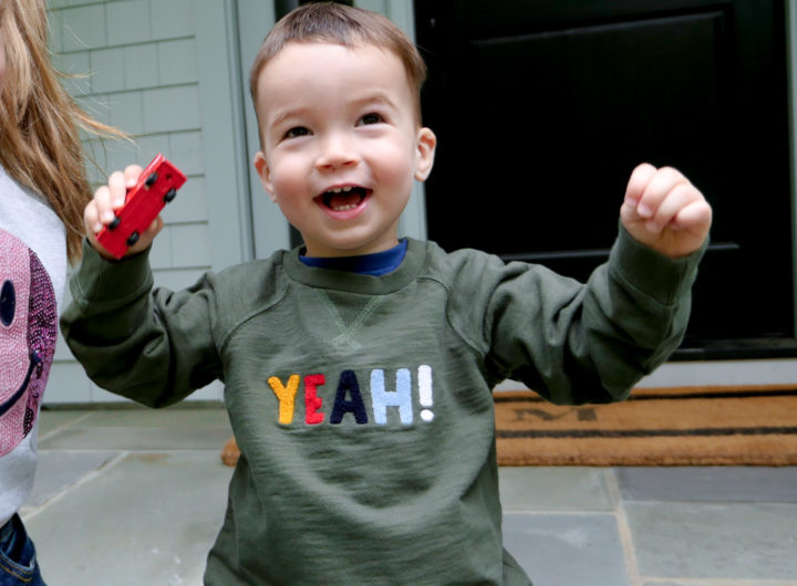Eva Amurri Martino's son Major throws his hands in the air wearing a 'yeah!' sweatshirt