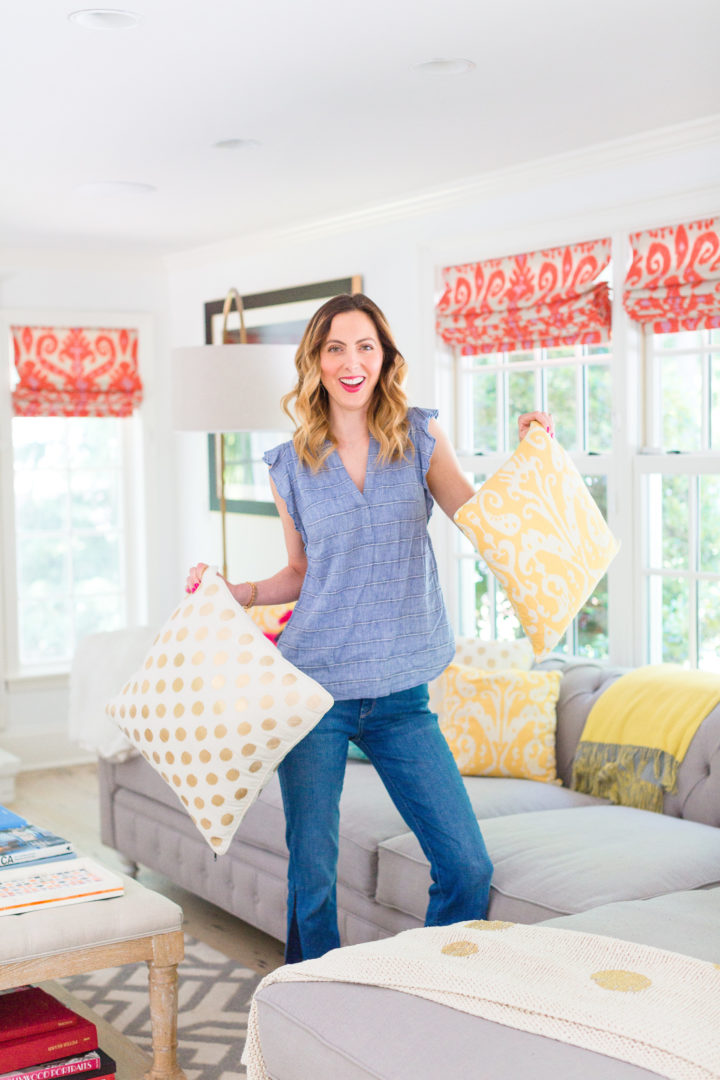 Eva Amurri Martino holds a colorful selection of pillows on her couch at her home in Connecticut