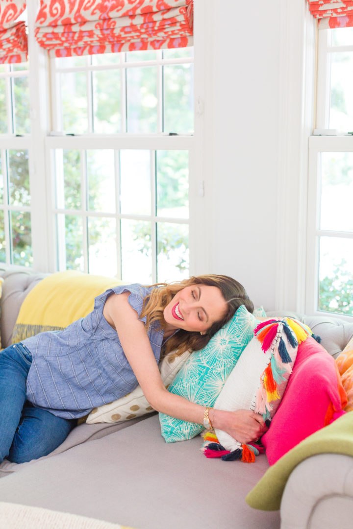 Eva Amurri Martino lays on a colorful selection of pillows on her couch at her home in Connecticut