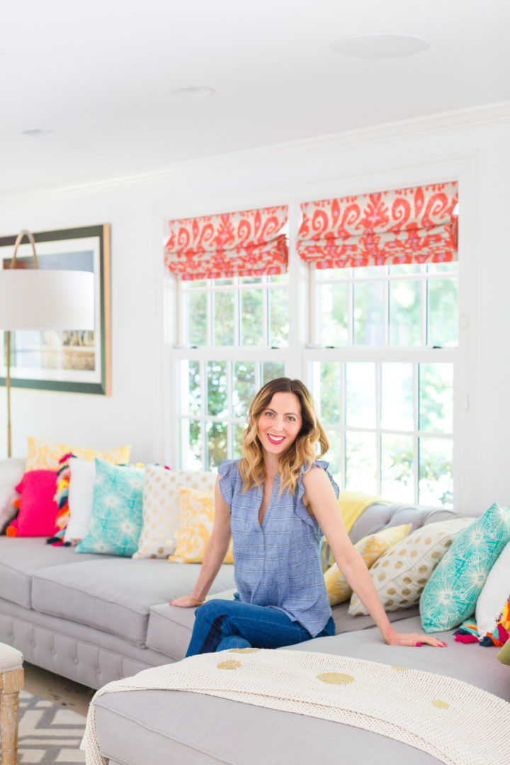 Eva Amurri Martino sits amongst a colorful selection of pillows on her couch at her home in Connecticut