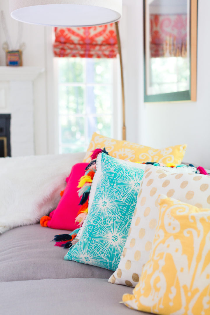 Eva Amurri Martino arranges a colorful selection of pillows on her couch at her home in Connecticut