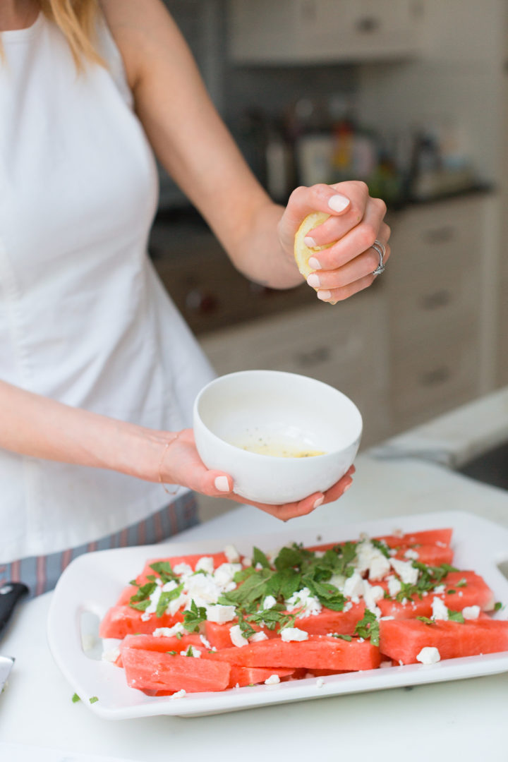 Eva Amurri Martino squeezes lemon into the dressing for her Watermelon & Feta salad