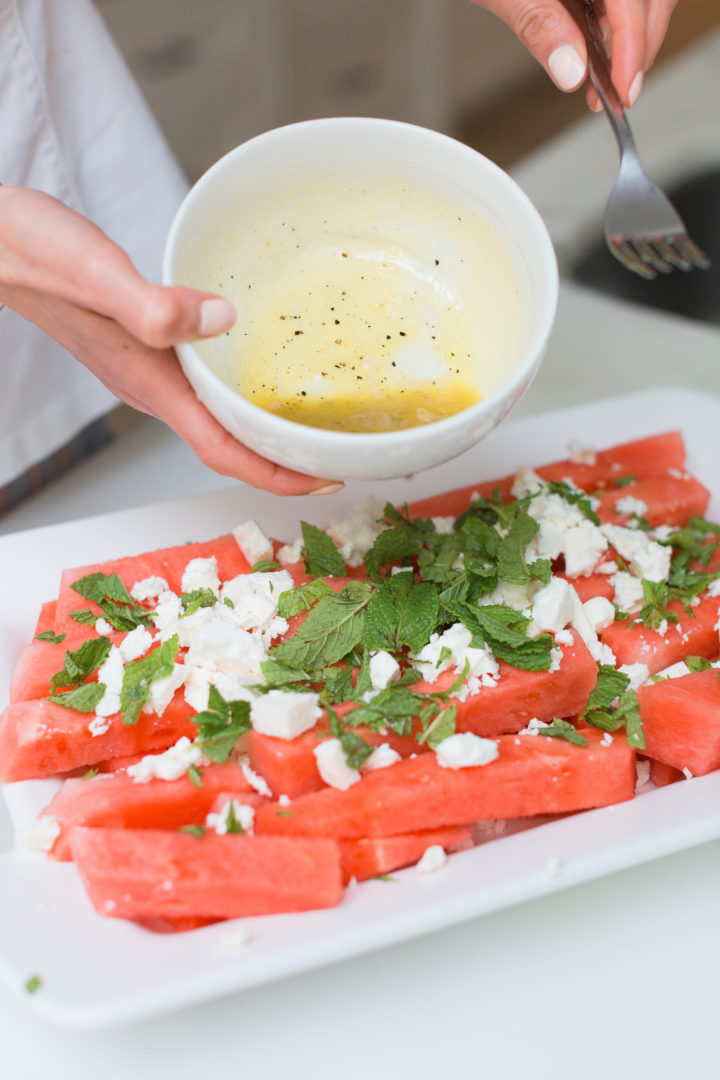 Eva Amurri Martino pours dressing onto her Watermelon & Feta salad