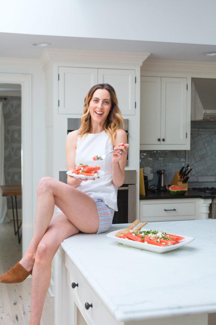 Eva Amurri Martino sits on her Carrera marble island eating Watermelon & Feta salad