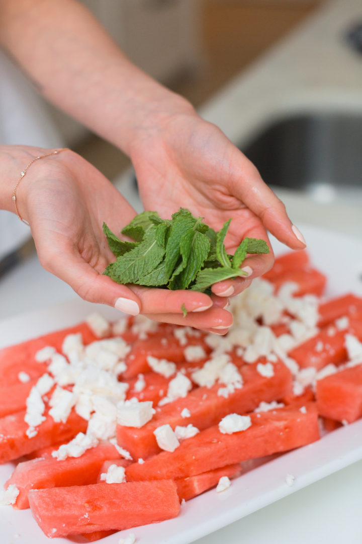 Eva Amurri Martino holds mint for her Watermelon & Feta salad