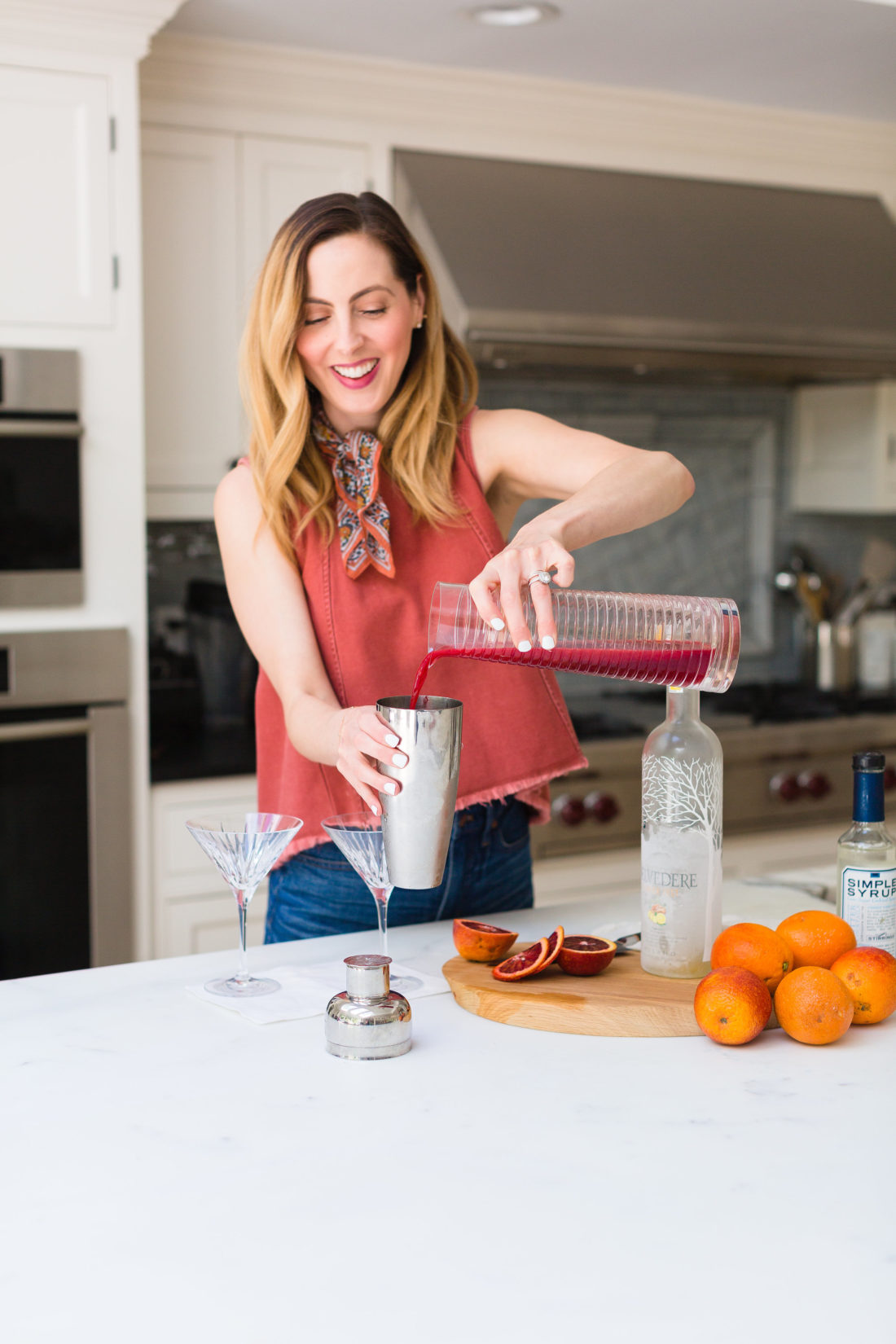 Eva Amurri Martino adds freshly squeezed blood orange juice to a cocktail shaker