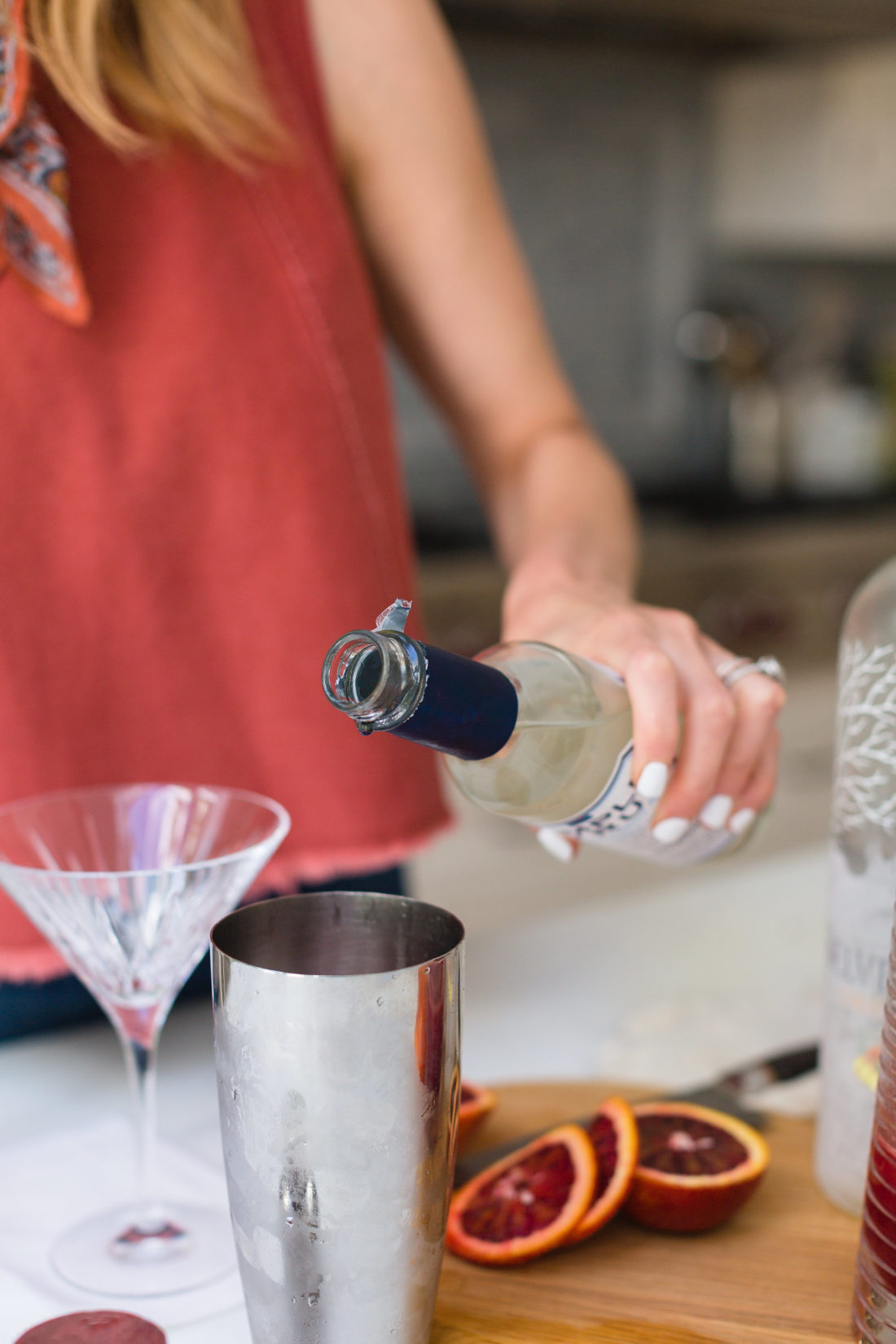 Eva Amurri Martino pours simple syrup in to her cocktail shaker in the kitchen of her connecticut home