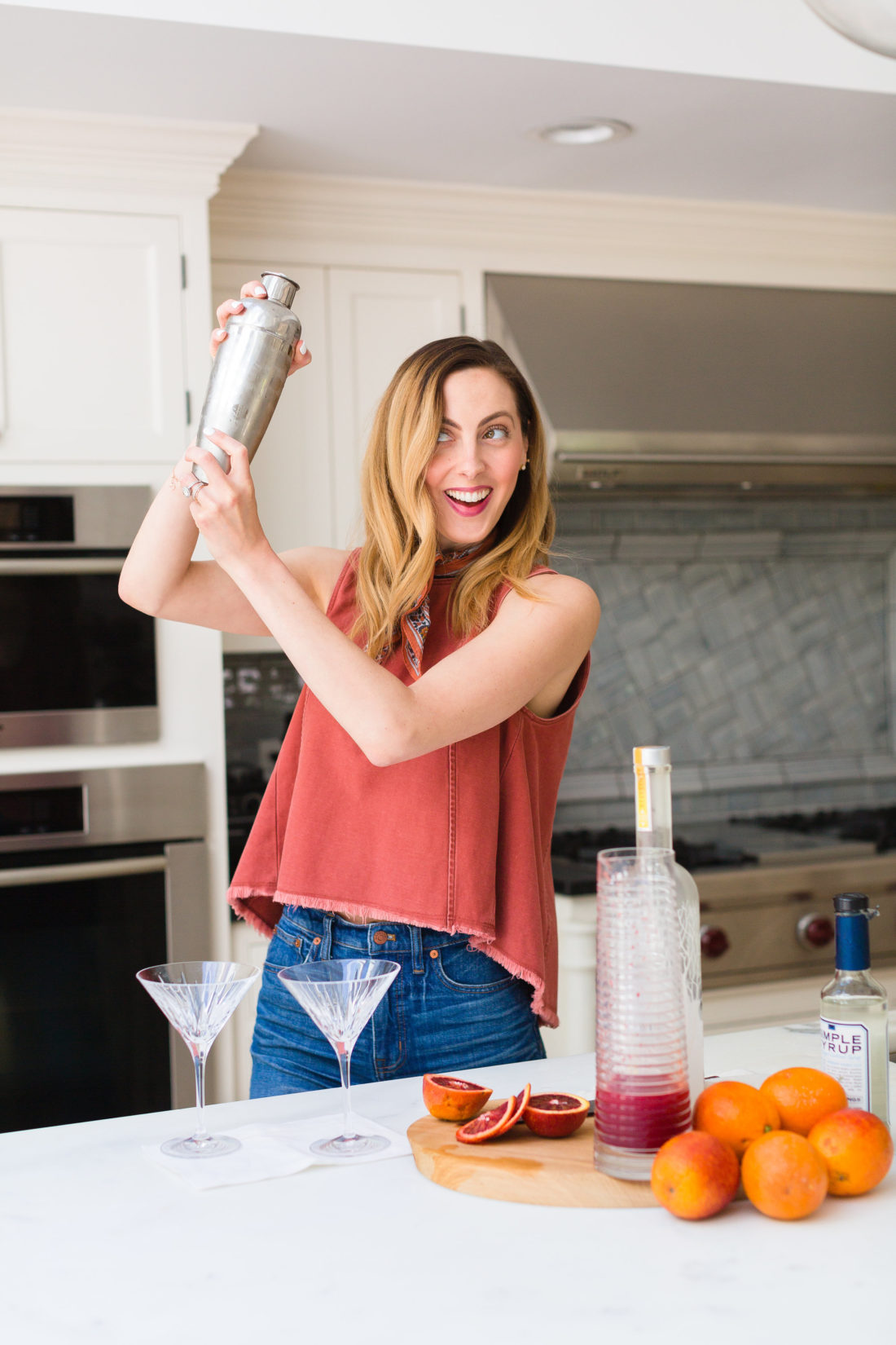Eva Amurri Martino shakes up her blood orange and ginger martinis in a stainless steel cocktail shaker in the kitchen of her Connecticut home