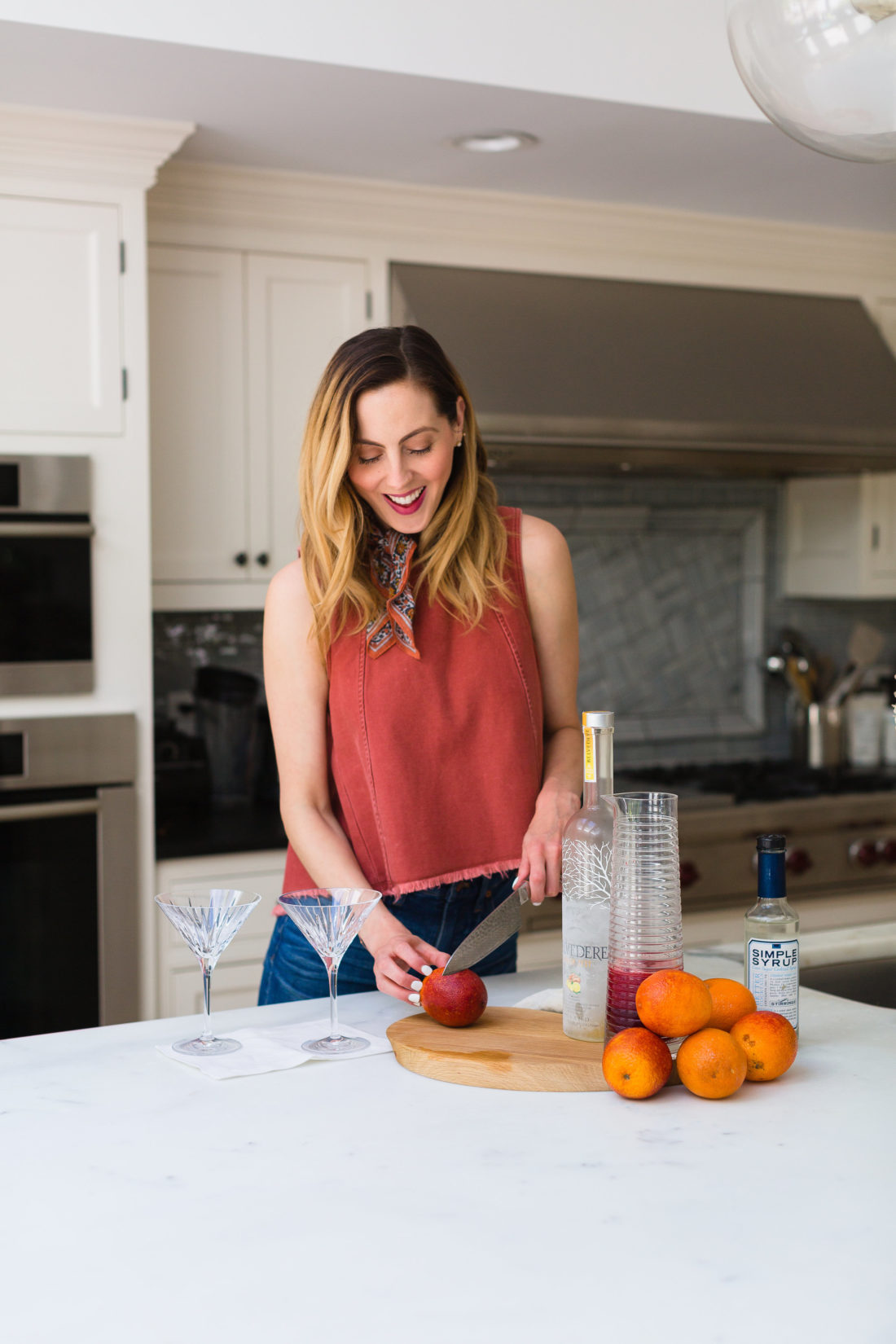 Eva Amurri Martino stands in the kitchen of her Connecticut home and slices blood oranges for martinis