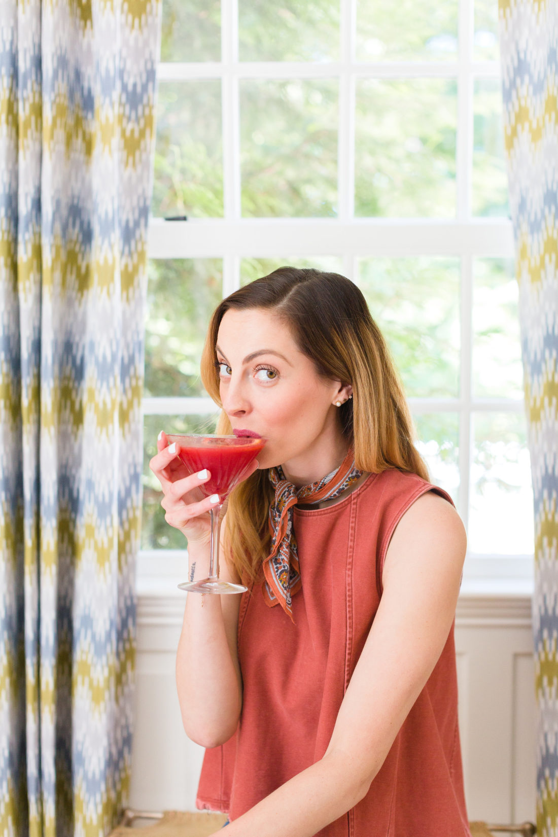 Eva Amurri Martino sips from a blood orange and ginger martini