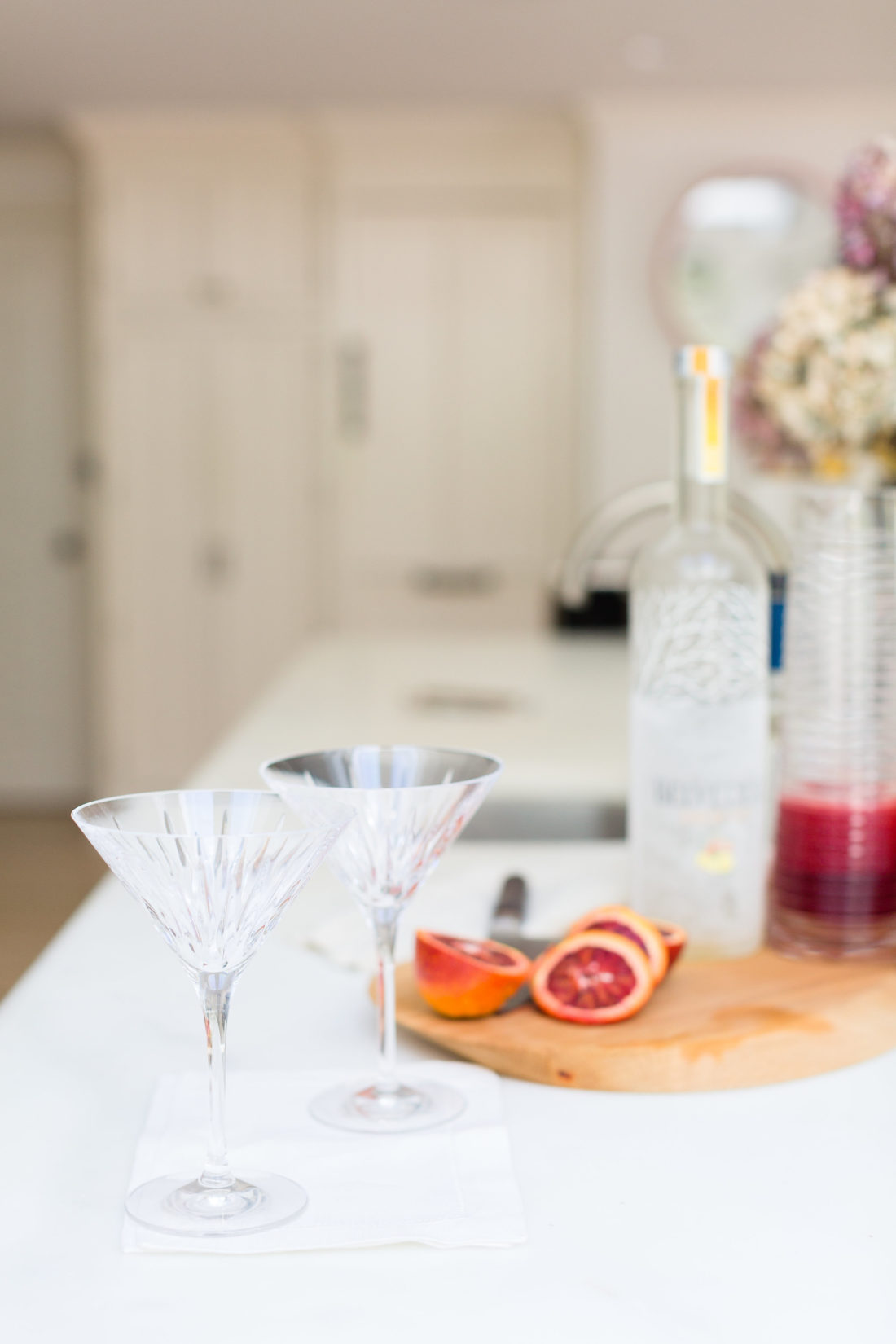 Eva Amurri Martino prepares to make blood orange and ginger martinis in the kitchen of her connecticut home