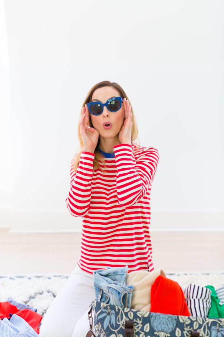 Eva Amurri Martino tries on sunglasses for her trip to Maine