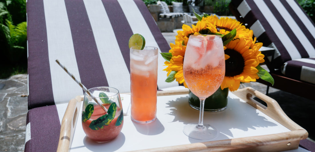 Eva Amurri Martino serves three different pink tinted cocktails to her guests poolside at her home in Connecticut