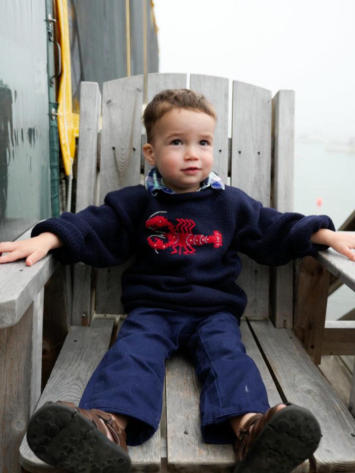 Eva Amurri Martino's son Major in a navy lobster sweater in Bar Harbor, ME.