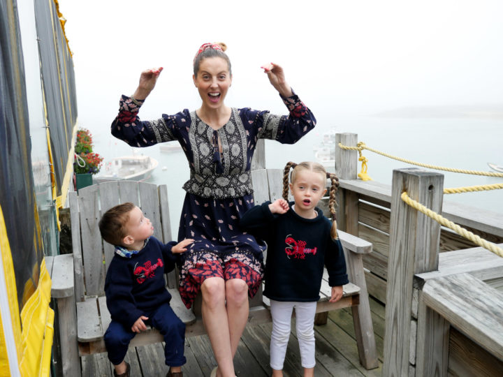 Eva Amurri Martino waves her hands like she just don't care, while her kids Marlowe and Major look on in matching lobster sweaters.