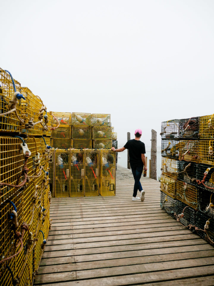 Eva Amurri Martino's husband Kyle looks out amongst the lobster crates in Bar Harbor, ME.