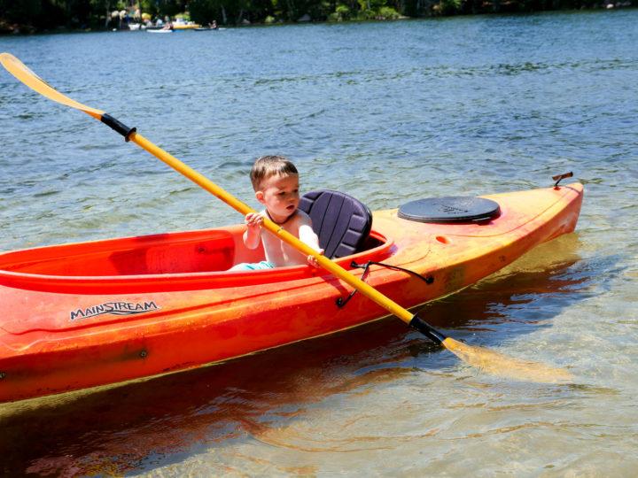 Eva Amurri Martino's son Major sits in a canoe in Bar Harbor, ME.