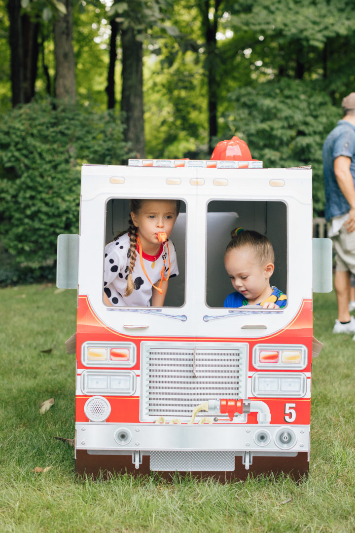Marlowe Martino and a friends at her 4th birthday party inside of Melissa & Doug fire truck