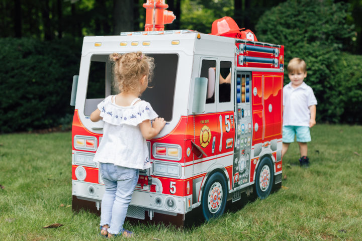 A partygoer at Marlowe Martino's 4th birthday party inside of Melissa & Doug fire truck