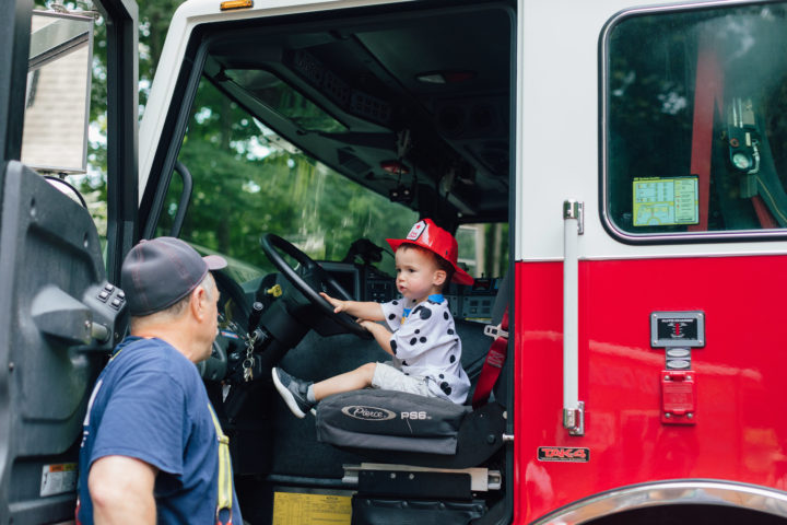 Eva Amurri Martino's son Major sitting in a firetruck with at his sister Marlowe's 4th birthday party