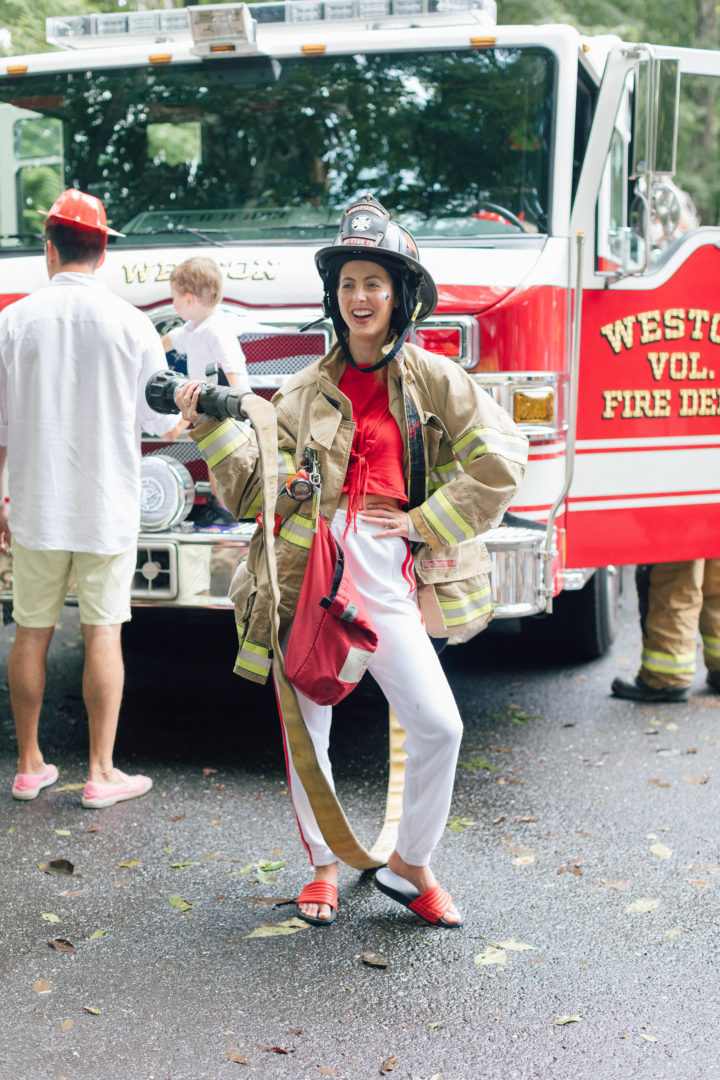 Eva Amurri Martino poses in fireman gear at her daughter Marlowe's 4th birthday party