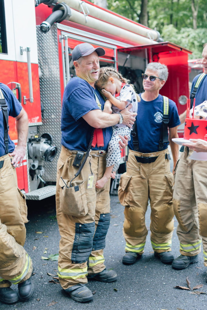 Eva Amurri Martino's daughter Marlowe talks to firemen at her 4th birthday party