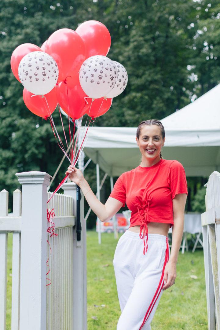 Eva Amurri Martino holds Red and white Dalmatian balloons at Marlowe Martino's 4th birthday