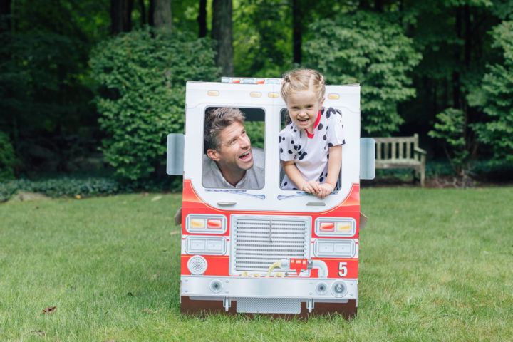 Marlowe Martino and dad Kyle at her 4th birthday party inside of Melissa & Doug fire truck