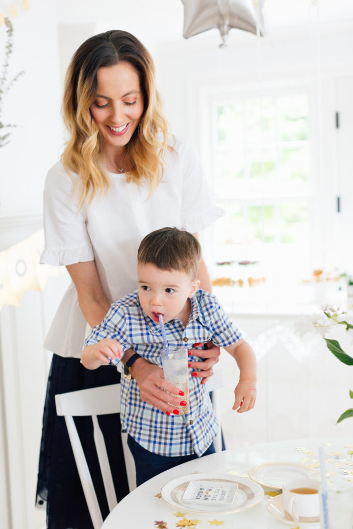 Eva Amurri Martino lifts up her son Major at her Eva Amurri Martino pours a cup of tea at her Celestial Baby Sprinkling Party