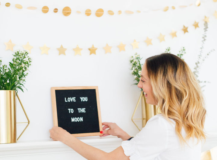 Eva Amurri Martino displays a 'Love You To The Moon' sign at her Celestial Baby Sprinkling Party