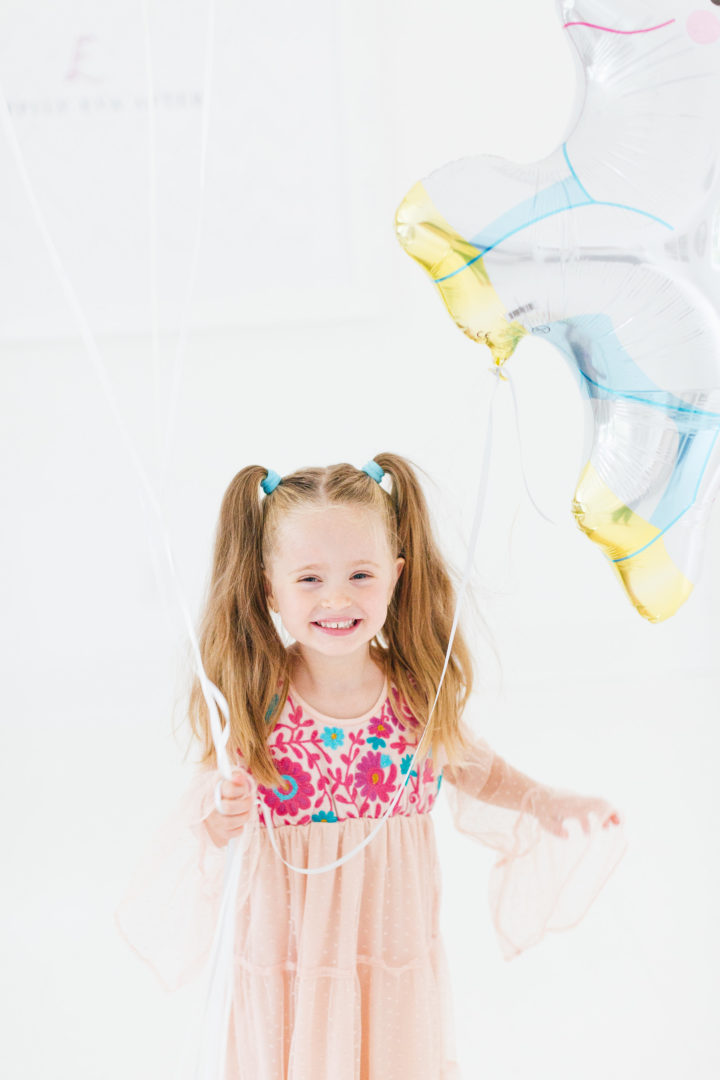 Eva Amurri Martino's daughter Marlowe holds a unicorn balloon for her 4th birthday