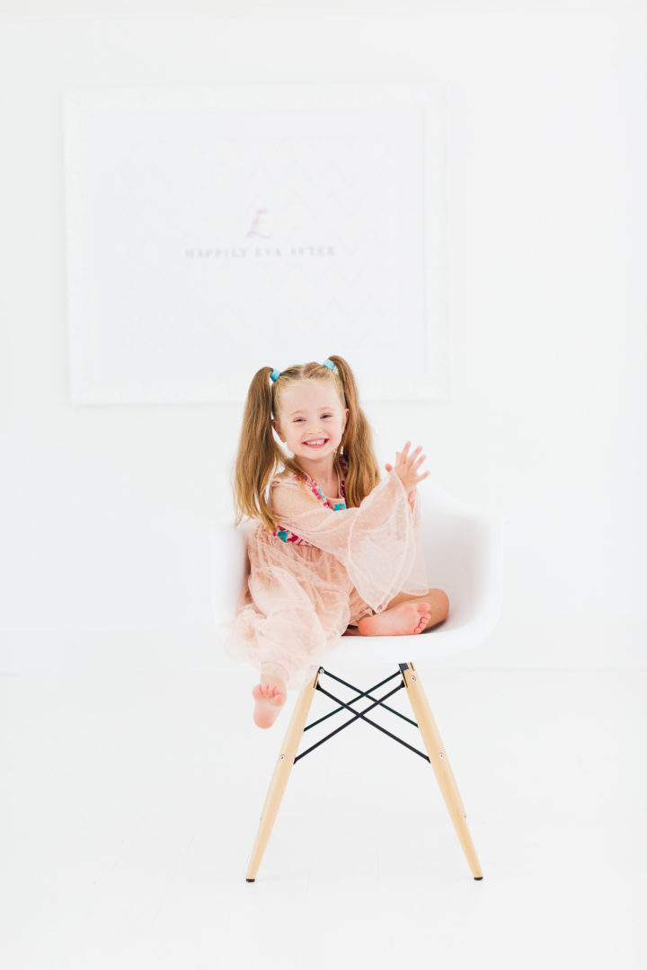 Eva Amurri Martino's daughter Marlowe sits in chair in her mom's studio