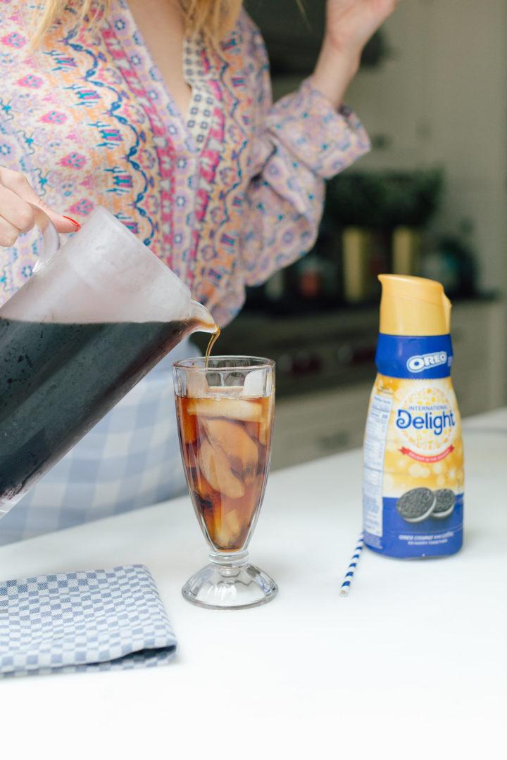 Eva Amurri Martino pours iced coffee into a glass