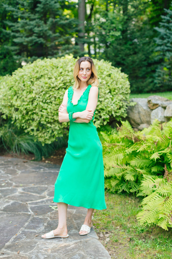 Eva Amurri Martino wears a bright green dress outside her home in Connecticut.