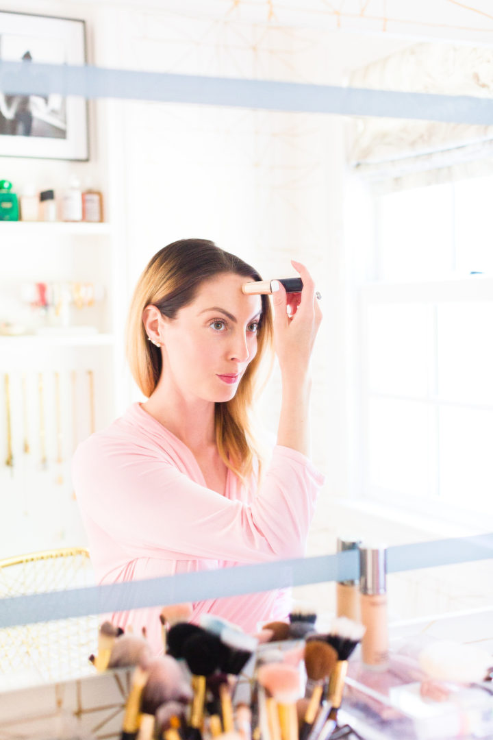Eva Amurri Martino applies concealer in the glam room of her Connecticut home