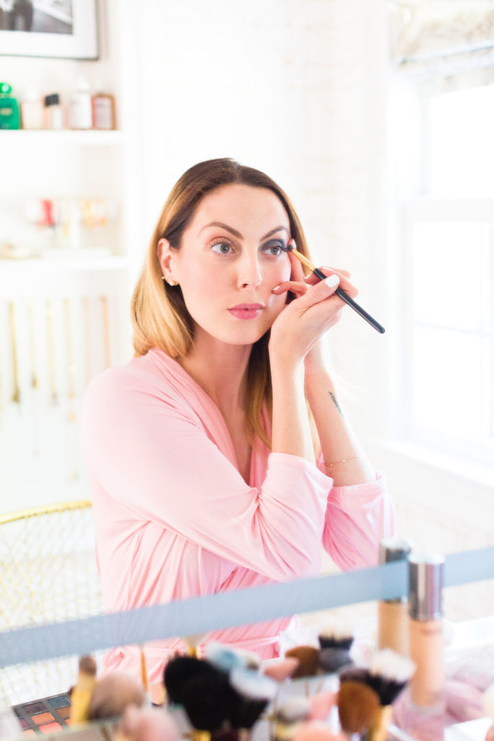 Eva Amurri Martino applies eyeshadow in the glam room of her Connecticut home