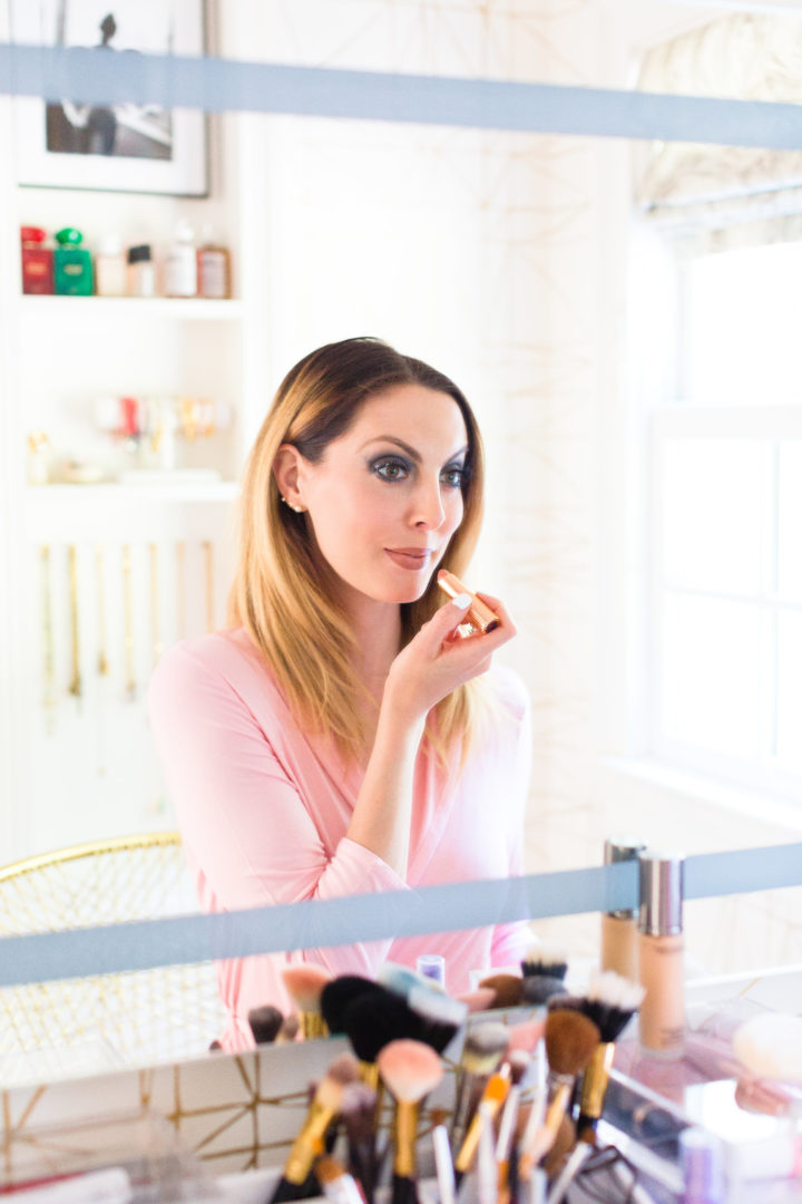 Eva Amurri Martino applies lipstick in the glam room of her Connecticut home